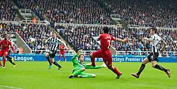 19.10.2013, St. James Park, New Castle, ENG, Premier League, ENG, Premier League, Newcastle United vs FC Liverpool, 8. Runde, im Bild Liverpool's Luis Suarez sets-up the second goal against Newcastle United // during the English Premier League 8th round match between Newcastle United and Liverpool FC St. James Park in New Castle, Great Britain on 2013/10/19. EXPA Pictures © 2013, PhotoCredit: EXPA/ Propagandaphoto/ David Rawcliffe<br /> <br /> *****ATTENTION - OUT of ENG, GBR*****