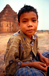 BURMA PAGAN MAR95 - A Burmese boy poses for a photograph in front of the Ananda Temple in the Bagan temple field. Bagan's temples are remains of a once-prosperous ancient kingdom and have been placed under UNESCO protection. . . jre/Photo by Jiri Rezac. . © Jiri Rezac 1995. . Contact: +44 (0) 7050 110 417. Mobile: +44 (0) 7801 337 683. Office: +44 (0) 20 8968 9635. . Email: jiri@jirirezac.com. Web: www.jirirezac.com