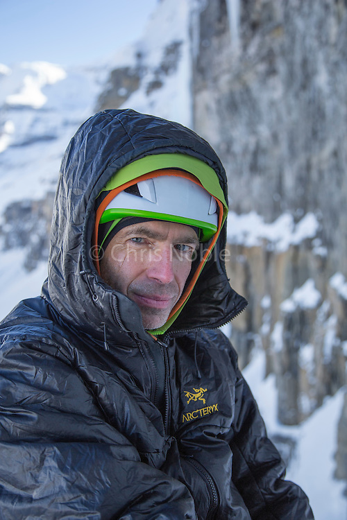 """Portrait of alpinist Raphael Slawinski belaying while climbing his route """"French Roast"""" WI 5, M6 on the Stanley Headwall in Kootenay Provincial Park (First Ascent 2008)"""