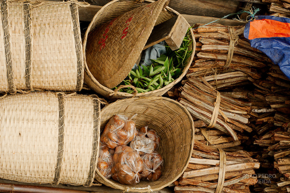 Produce arriving at a rural market in the Inle Lake region on a boat