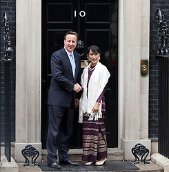 © Licensed to London News Pictures. 21/06/2012. LONDON, UK. Burmese Nobel peace prize winner and former political prisoner Aung San Suu Kyi meets British Prime Minister David Cameron at number 10 Downing Street in London toda (21/0612). Aung San Suu Kyi, the leader of the Burmese opposition, today met with the British Prime Minister David Cameron as part of a trip to the UK. Photo credit: Matt Cetti-Roberts/LNP