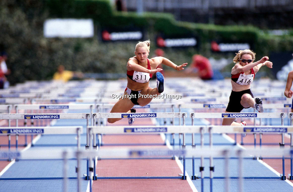 Andrea Miller in action during the hurdles during the national athletics champs, 3 March, 2002. Photo: PHOTOSPORT