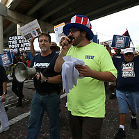 Many protesters hold up signs during the Republican National Convention in Tampa, Fla. on Wednesday, August 29, 2012. (AP Photo/Alex Menendez)