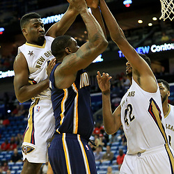 Oct 4, 2016; New Orleans, LA, USA;  New Orleans Pelicans forward Solomon Hill (44) blocks a shot by Indiana Pacers center Kevin Seraphin (1) during the first quarter of a game at the Smoothie King Center. Mandatory Credit: Derick E. Hingle-USA TODAY Sports