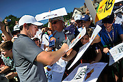Jul 27, 2016; Springfield, NJ, USA; Rory McIlroy signs autographs during a practice round for the 2016 PGA Championship golf tournament at Baltusrol GC - Lower Course. Mandatory Credit: Eric Sucar-USA TODAY Sports