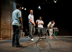 "© Copyright licensed to London News Pictures. 12/11/2010. ""Inside"" by Philip Osment, presented by Playing Out at the Roundhouse, Camden, London. Based on the real experiences of young fathers in prison, the play deals with big questions surrounding relationships, both with their own fathers and with their children. L o R: Michael Amaning, Kyle Thorne, Darren Douglas, Ayo Bodunrin."