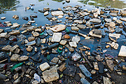 Plastic bottles, polystyrene and other garbage floating in ocean in Negombo, Sri Lanka