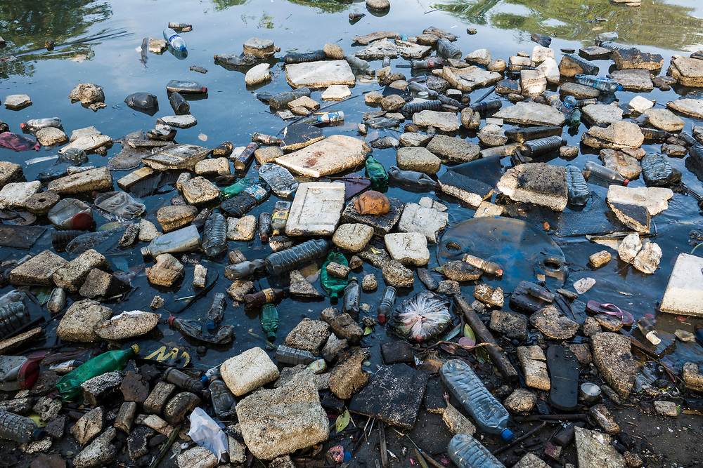 Plastic bottles, polystyrene and other garbage floating in ocean in Negombo, Sri Lanka