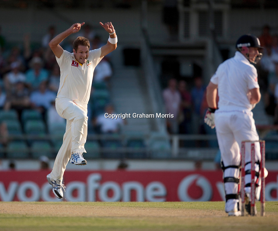 Paul Collingwood is caught off the bowling of Ryan Harris (celebrating) during the third Ashes test match between Australia and England at the WACA (West Australian Cricket Association) ground in Perth, Australia. Photo: Graham Morris (Tel: +44(0)20 8969 4192 Email: sales@cricketpix.com) 18/12/10