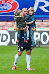 WREXHAM, WALES - Saturday, May 3, 2014: The New Saints' Philip Baker with his children after the Welsh Cup Final against Aberystwyth Town at the Racecourse Ground. (Pic by David Rawcliffe/Propaganda)