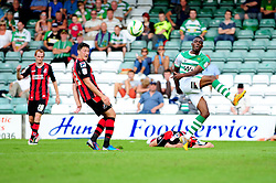 After fouling Bournemouth's Adam Barrett, Yeovil Town's Gozie Ugwa kicks the ball away in frustration - Photo mandatory by-line: Dougie Allward/Josephmeredith.com  - Tel: Mobile:07966 386802 08/09/2012 - SPORT - FOOTBALL - League 1 -  Yeovil  - Huish Park -  Yeovil Town v AFC Bournemouth