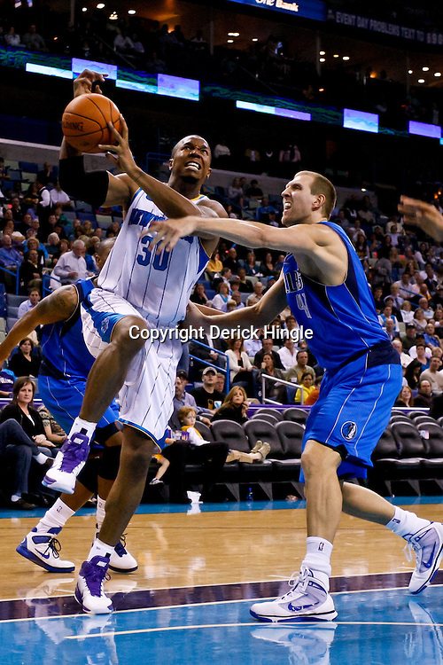 November 17, 2010; New Orleans, LA, USA; New Orleans Hornets power forward David West (30) drives past Dallas Mavericks power forward Dirk Nowitzki (41) of Germany during a game at the New Orleans Arena. The Hornets defeated the Mavericks 99-97. Mandatory Credit: Derick E. Hingle