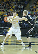 December 28, 2011: Iowa Hawkeyes forward Zach McCabe (15) tries to keep the ball away from Purdue Boilermakers forward Robbie Hummel (4) during the NCAA basketball game between the Purdue Boilermakers and the Iowa Hawkeyes at Carver-Hawkeye Arena in Iowa City, Iowa on Wednesday, December 28, 2011. Purdue defeated Iowa 79-76.
