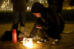 "© under license to London News Pictures.  09/12/2010 A man lights a candle at a ""vigil to mark the death of education"" in Plymouth this evening (Thursday), as the result of the vote on education fees comes in. Picture credit should read: David Hedges/LNP"