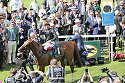 FRANKIE DETTORI celebrates and gestures to the crowd on board STRADIVARIUS after winning The Group 2 Weatherbys Hamilton Lonsdale Cup over 2m (£225,000)   during the Ebor Festival at York Racecourse, York, United Kingdom on 23 August 2019.