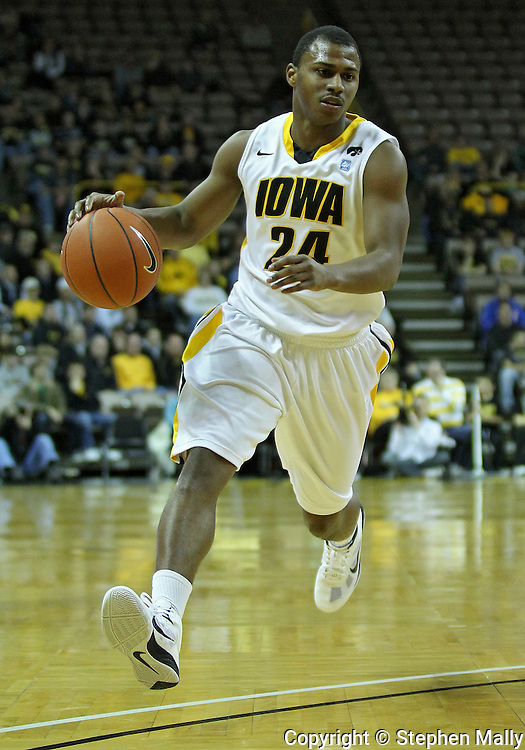 January 04 2010: Iowa Hawkeyes guard Bryce Cartwright (24) drives with the ball during the first half of an NCAA college basketball game at Carver-Hawkeye Arena in Iowa City, Iowa on January 04, 2010. Ohio State defeated Iowa 73-68.