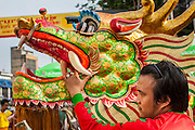 14 OCTOBER 2012 - BANGKOK, THAILAND:    Chinese dancers leave a shrine on Yaowarat Road after making merit on the first day of the Vegetarian Festival in Bangkok's Chinatown. The Vegetarian Festival is celebrated throughout Thailand. It is the Thai version of the The Nine Emperor Gods Festival, a nine-day Taoist celebration beginning on the eve of 9th lunar month of the Chinese calendar. During a period of nine days, those who are participating in the festival dress all in white and abstain from eating meat, poultry, seafood, and dairy products. Vendors and proprietors of restaurants indicate that vegetarian food is for sale by putting a yellow flag out with Thai characters for meatless written on it in red.       PHOTO BY JACK KURTZ