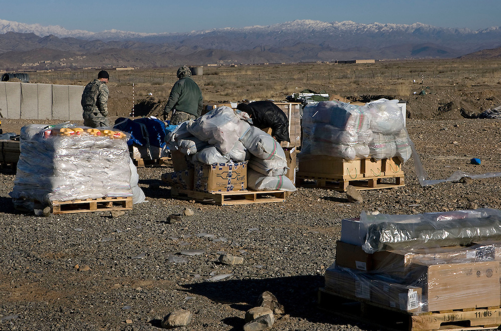 Pallets of food, fuel and clothing ready to be loaded onto CH-47 Chinook helicopers and flown to the village of Rebat as part of a humanitarian assistance mission called Operation 'Winterstand'. FOB Bermel, Paktika Province, Afghanistan on the 18th of January 2008.