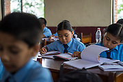 Usha (name changed), aged 10, studies in her classroom in SOS Children's Villages Sanothimi, Bhaktapur, Nepal on 2 July 2015. Usha's entire family perished when her house collapsed in the earthquake on 25th April 2015. Usha is now well integrated into her new family and school. Photo by Suzanne Lee for SOS Children's Villages