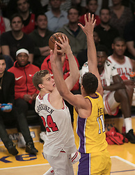November 21, 2017 - Los Angeles, California, United States of America - Lauri Markkanen #24 of the Chicago Bulls  takes a shot as Brook Lopez #11 of the Los Angeles Lakers defends during their game on Tuesday November 21, 2017 at the Staples Center in Los Angeles, California. Lakers defeat Bulls, 103-94. JAVIER ROJAS/PI (Credit Image: © Prensa Internacional via ZUMA Wire)