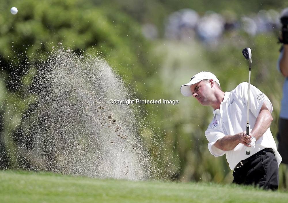 David Smail (NZ) plays out of the bunker during the Holden New Zealand Golf Open at Gulf Harbour, Whangaparaoa, New Zealand on Thursday 10th February, 2005.<br />