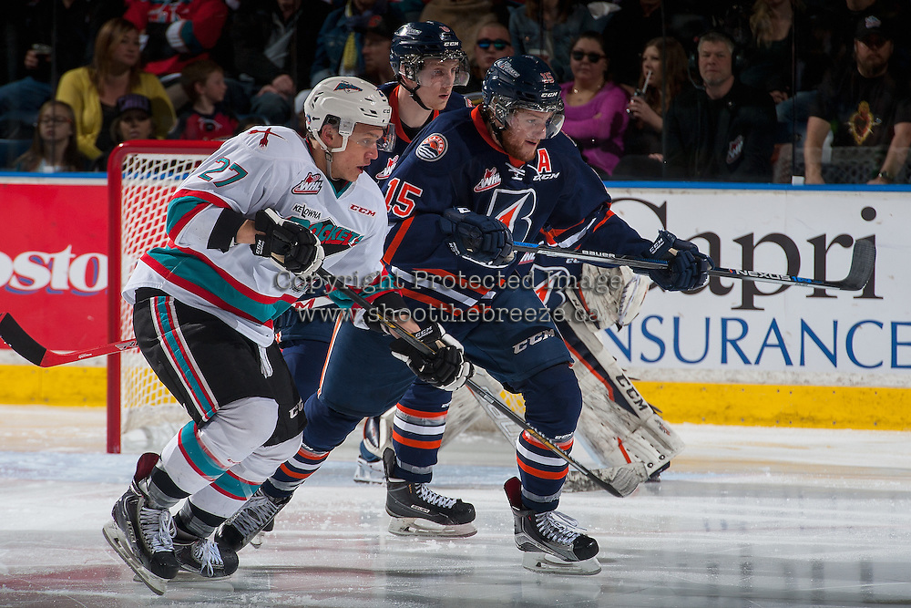 KELOWNA, CANADA - APRIL 1: Calvin Thurkauf #27 of Kelowna Rockets checks Collin Shirley #15 of Kamloops Blazers during second period on April 1, 2016 at Prospera Place in Kelowna, British Columbia, Canada.  (Photo by Marissa Baecker/Shoot the Breeze)  *** Local Caption *** Calvin Thurkauf; Collin Shirley;