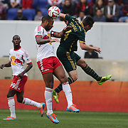 Thierry Henry, (left), New York Red Bulls, wins a header while challenged by Ben Zemanski, Portland Timbers, during the New York Red Bulls Vs Portland Timbers, Major League Soccer regular season match at Red Bull Arena, Harrison, New Jersey. USA. 24th May 2014. Photo Tim Clayton