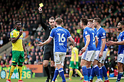 Referee David Coote shows Ipswich Town defender Callum Connolly (16) the yellow card during the EFL Sky Bet Championship match between Norwich City and Ipswich Town at Carrow Road, Norwich, England on 18 February 2018. Picture by Nigel Cole.
