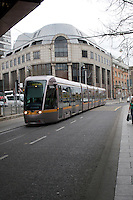 LUAS tram leaving Abbey Street in Dublin Ireland. LUAS (Irish for speed) is Dublin's light rail system
