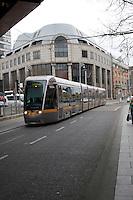 LUAS tram leaving Abbey Street in Dublin Ireland. LUAS (Irish for speed) is Dublin's light rail system