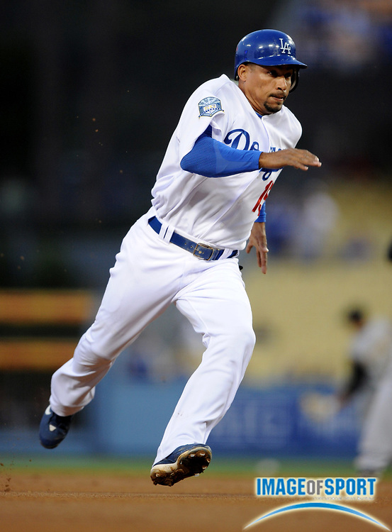 Apr 16, 2008; Los Angeles, CA, USA; Los Angeles Dodgers shortstop Rafael Furcal (15) runs toward third base in the first inning against the Pittsburgh Pirates at Dodger Stadium.