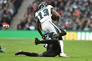 Jacksonville Jaguars Ronnie Harrison S (36) tackles Philadelphia Eagles Nelson Agholor WR (13) during the International Series match between Jacksonville Jaguars and Philadelphia Eagles at Wembley Stadium, London, England on 28 October 2018.