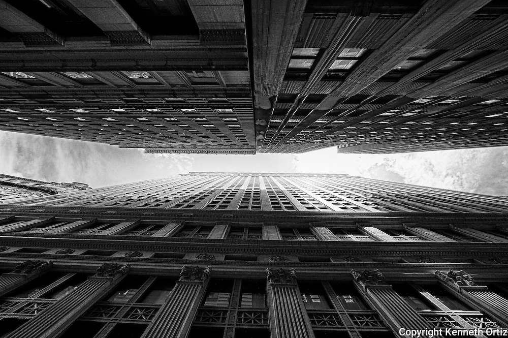 A Worms eye view of the buildings on Pine Street between Nassau and Broadway streets in the financial district in lower Manhattan.