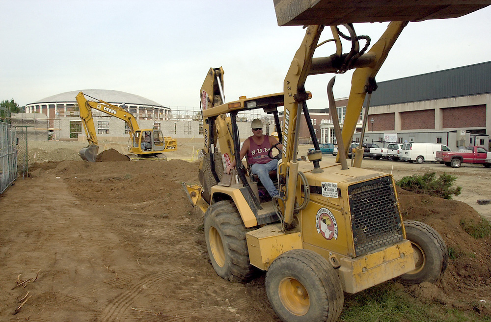 Construction worker Jeff Lucas works on grating a future parking lot at the construction site for a new lecture hall facility next to the Convocation Center on Ohio University's campus on Wednesday September 25, 2002.