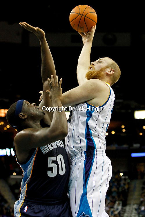 December 21, 2011; New Orleans, LA, USA; New Orleans Hornets center Chris Kaman (35) shoots over Memphis Grizzlies power forward Zach Randolph (50) during the second quarter of a game at the New Orleans Arena.   Mandatory Credit: Derick E. Hingle-US PRESSWIRE