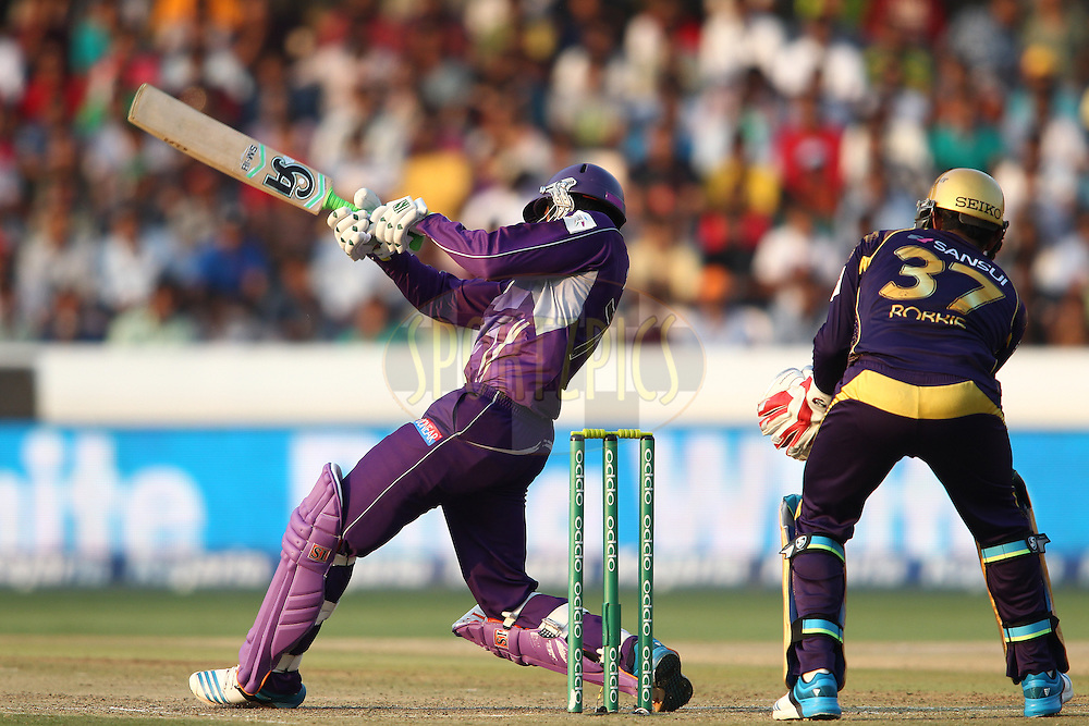 Shoaib Malik of the Hobart Hurricanes a delivery for six to bring up his fifty during the first semi final match of the Oppo Champions League Twenty20 between the Kolkata Knight Riders and the Hobart Hurricanes held at the Rajiv Gandhi Cricket Stadium, Hyderabad, India on the 2nd October 2014<br /> <br /> Photo by:  Shaun Roy / Sportzpics/ CLT20<br /> <br /> <br /> Image use is subject to the terms and conditions as laid out by the BCCI/ CLT20.  The terms and conditions can be downloaded here:<br /> <br /> http://sportzpics.photoshelter.com/gallery/CLT20-Image-Terms-and-Conditions-2014/G0000IfNJn535VPU/C0000QhhKadWcjYs