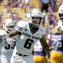 Oct 5, 2019; Baton Rouge, LA, USA; Utah State Aggies cornerback Cameron Haney (6) celebrates after a interception against the LSU Tigers during the first quarter at Tiger Stadium. Mandatory Credit: Derick E. Hingle-USA TODAY Sports