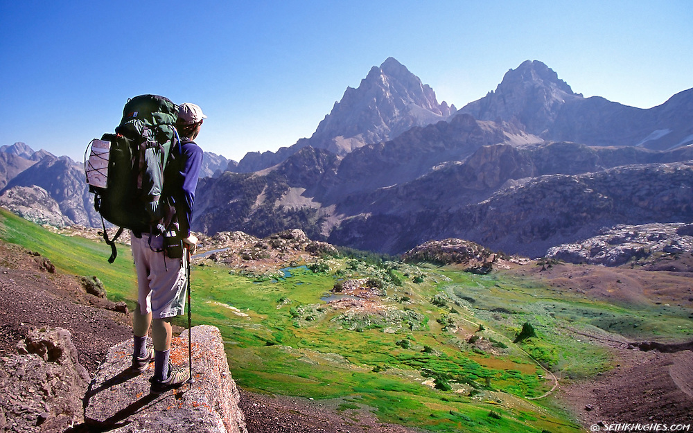 A backpacker stops to admire the view atop of Hurricane Pass in the Grand Teton National Park, Wyoming.