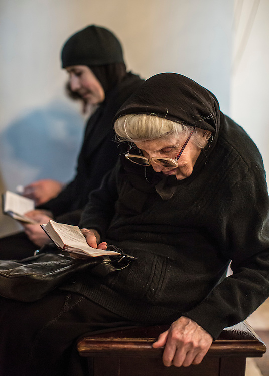 VAGHARSHAPAT, ARMENIA - APRIL 23: Women read books of prayers inside Etchmiadzin Cathedral, which is the mother church of the Armenian Apostolic Church and is considered the oldest cathedral in the world, before a canonization ceremony for victims of the Armenian genocide on April 23, 2015 in Vagharshapat, Armenia. Tomorrow will mark the one hundredth anniversary of events generally considered to be the start of a campaign of genocide against minority ethnic Armenians living in present-day eastern Turkey by the Ottoman government over fears of their allegiance during World War I. (Photo by Brendan Hoffman/Getty Images) *** Local Caption ***