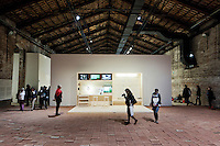 """VENICE, ITALY - 31 MAY 2013: Elisabetta Benassi's """"The Dry Salvages"""" (2013) - approximately 10,000 bricks, sand, book - and Gianfranco Baruchello's """"Piccolo sistema"""" (2012-2013) - wooden structure and various materials - at the Italian Pavillon, at the Arsenale of the Biennale in Venice, Italy, on May 31st 2013. <br /> <br /> The Italian Pavilion presents vice versa, an ideal journey through Italian art of today,<br /> an itinerary that tells of identities, history and landscapes - real and imaginary - exploring the complexity and layers that characterize the country's artistic vicissitudes. The Italian Pavillon is curated by Bartolomeo Pietromarchi,<br /> who describes the exhibition as, ?A portrait of recent art, read as an atlas of themes and attitudes in dialogue with the historical legacy and current affairs, with both a local and international dimension. A cross-dialogue of correspondences, derivations and differences between acclaimed maestros and artists of later generations"""". The exhibition is divided into seven spaces - six rooms and a garden - that each house<br /> the work of two artists,<br /> who are brought together on the basis of the affinity of their<br /> respective poetics and common interests in themes, ideas and practices.<br /> <br /> The 55th International Art Exhibition of the Venice Biennale takes place in Venice from June 1st to November 24th, 2013 at the Giardini and at the Arsenale as well as in various venues the city. <br /> <br /> Gianni Cipriano for The New York TImes"""