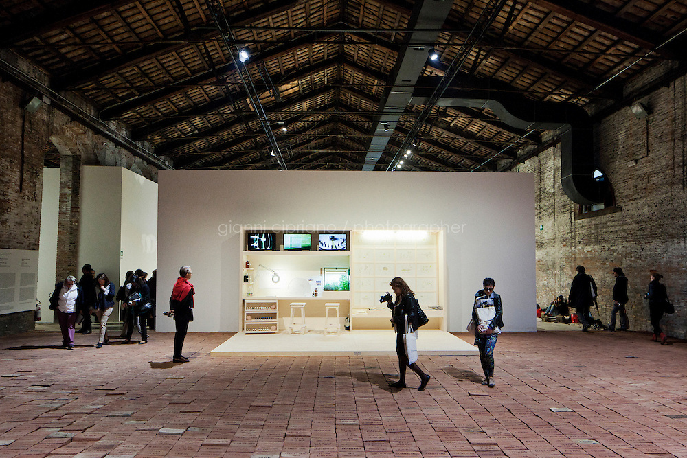 VENICE, ITALY - 31 MAY 2013: Elisabetta Benassi's &quot;The Dry Salvages&quot; (2013) - approximately 10,000 bricks, sand, book - and Gianfranco Baruchello's &quot;Piccolo sistema&quot; (2012-2013) - wooden structure and various materials - at the Italian Pavillon, at the Arsenale of the Biennale in Venice, Italy, on May 31st 2013. <br /> <br /> The Italian Pavilion presents vice versa, an ideal journey through Italian art of today,<br /> an itinerary that tells of identities, history and landscapes - real and imaginary - exploring the complexity and layers that characterize the country's artistic vicissitudes. The Italian Pavillon is curated by Bartolomeo Pietromarchi,<br /> who describes the exhibition as, ?A portrait of recent art, read as an atlas of themes and attitudes in dialogue with the historical legacy and current affairs, with both a local and international dimension. A cross-dialogue of correspondences, derivations and differences between acclaimed maestros and artists of later generations&quot;. The exhibition is divided into seven spaces - six rooms and a garden - that each house<br /> the work of two artists,<br /> who are brought together on the basis of the affinity of their<br /> respective poetics and common interests in themes, ideas and practices.<br /> <br /> The 55th International Art Exhibition of the Venice Biennale takes place in Venice from June 1st to November 24th, 2013 at the Giardini and at the Arsenale as well as in various venues the city. <br /> <br /> Gianni Cipriano for The New York TImes