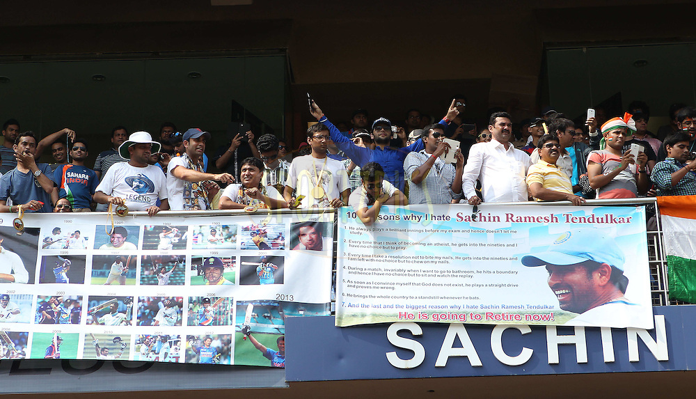 Fans bid farewell to Sachin Tendulkar of India  during day one of the second Star Sports test match between India and The West Indies held at The Wankhede Stadium in Mumbai, India on the 14th November 2013<br /> <br /> This test match is the 200th test match for Sachin Tendulkar and his last for India.  After a career spanning more than 24yrs Sachin is retiring from cricket and this test match is his last appearance on the field of play.<br /> <br /> <br /> Photo by: Ron Gaunt - BCCI - SPORTZPICS<br /> <br /> Use of this image is subject to the terms and conditions as outlined by the BCCI. These terms can be found by following this link:<br /> <br /> http://sportzpics.photoshelter.com/gallery/BCCI-Image-Terms/G0000ahUVIIEBQ84/C0000whs75.ajndY