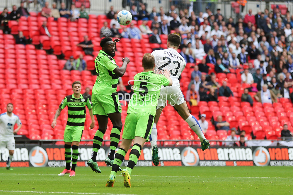 Forest Green Rovers Manny Monthe(3) and Forest Green Rovers Mark Ellis(5) defends against Tranmere Rovers Cole Stockton(23) during the Vanarama National League Play Off Final match between Tranmere Rovers and Forest Green Rovers at Wembley Stadium, London, England on 14 May 2017. Photo by Shane Healey.