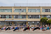 Children practicing for the school sports day in the playground of Tsukushino Elementary School, Machida, Tokyo, Japan. Friday May 30th 2014