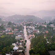 Sunrise and mist over Luang Prabang from Mount Phousi