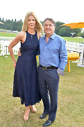 RAYMOND BLANC and NATALIA TRAXEL at the Veuve Clicquot Gold Cup Final at Cowdray Park Polo Club, Midhurst, West Sussex on 20th July 2014.