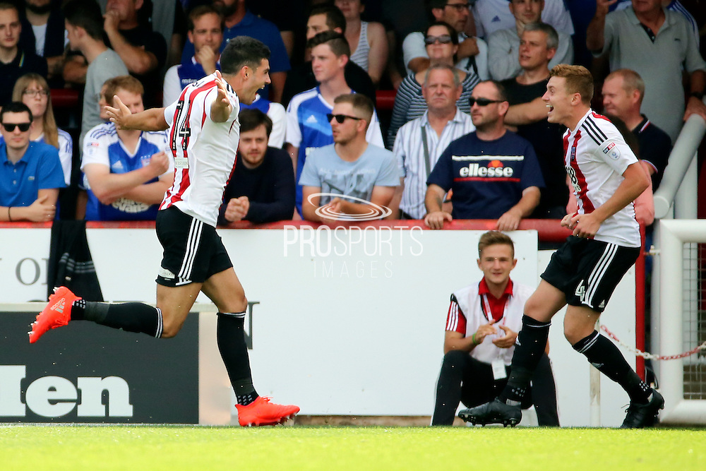 Brentford defender John Egan (14) celebrating, scoring 1-0 during the EFL Sky Bet Championship match between Brentford and Ipswich Town at Griffin Park, London, England on 13 August 2016. Photo by Matthew Redman.