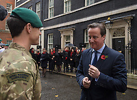 20121110       Copyright image 2012©.Serving and Former Royal Marines Commandos are welcomed to Downing Street, central London, by the British Prime Minister, David Cameron, MP, prior to a gruelling Remembrance Weekend, Military Marathon..For further info Please contact.Simon.Bright@captiveminds.com.Commando 999 fund raising speed march through London.For photographic enquiries please call Anthony Upton 07973 830 517 or email info@anthonyupton.com .This image is copyright Anthony Upton 2012©..This image has been supplied by Anthony Upton and must be credited Anthony Upton. The author is asserting his full Moral rights in relation to the publication of this image. All rights reserved. Rights for onward transmission of any image or file is not granted or implied. Changing or deleting Copyright information is illegal as specified in the Copyright, Design and Patents Act 1988. If you are in any way unsure of your right to publish this image please contact Anthony Upton on +44(0)7973 830 517 or email: