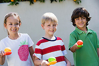 Kids Holding Eggs in Spoons for Egg Race