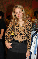 BAY GARNETT at a Topshop hosted Jumbo Thrift Sale - a sale of designer fashion, in association with the Terence Higgins Trust for World Aids Day, held at Topshop, Oxford Circus, London on 1st December 2004.<br />